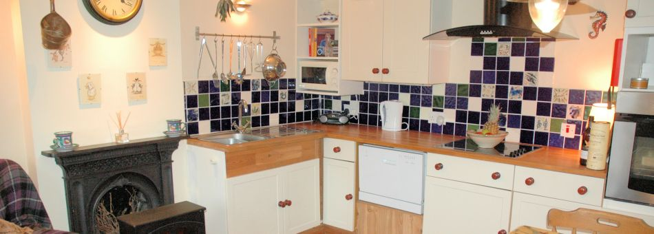 The kitchen in Roseate Cottage is well equipped and has been tastefully modernised whilst retaining traditional charm.